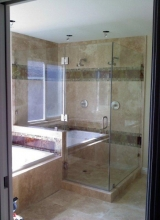 "3/8"" Clear Tempered Glass 90 Degree Shower Enclosure using Clips on the Stationary Panels with Glass to Glass Hinges and a Glass to Wall Hinge on the Door, and a 6"" Back to Back Handle in Brushed Nickel Trim"