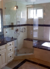 "3/8"" Clear Tempered Glass Frameless Custom Neo-Angle Shower Enclosure with the glass Notched to go over the Tub Deck, Bench Seat and Vanity using Three Glass to Glass Hinges, one 6"" Back to Back Handle with Washers, and Clips on the Stationary Panels using Chrome Hardware"